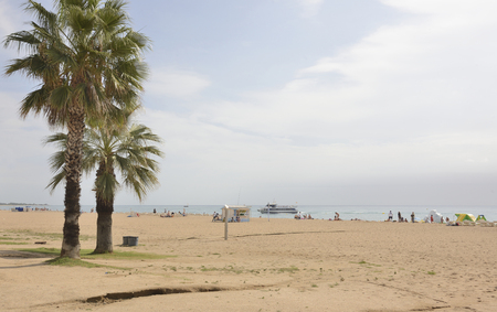 Santa Susanna,Spain-September 17,2014: Tourists walking and sunbathing on the beach