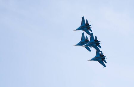 aerobatic: Rostov-on-Don, Russia- March 21, 2015:  Aerobatic team Russian Knights on the Su-27 at the event for the 70th anniversary of Victory in Great Patriotic War