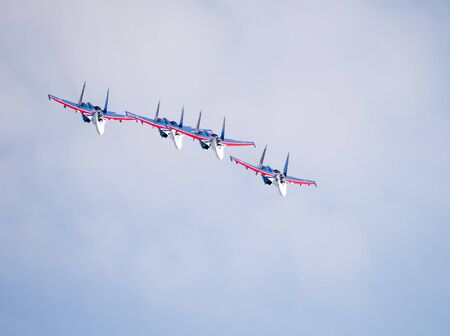 Rostov-on-Don, Russia- March 21, 2015:  Aerobatic team Russian Knights on the Su-27 at the event for the 70th anniversary of Victory in Great Patriotic War
