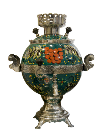 Samovar - a machine for preparing hot water. Is isolated on the white Stock Photo