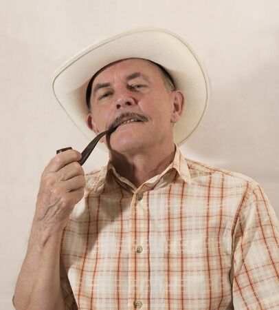 Cowboy in white hat with Pipe