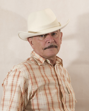 aging american: Cowboy in white hat