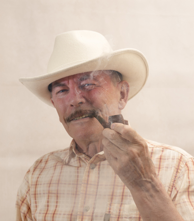 Cowboy in white hat with Pipe photo