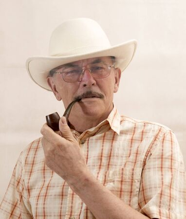 hillbilly: Cowboy in white hat with Pipe