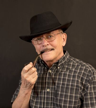 hillbilly: Cowboy in hat with Pipe Stock Photo