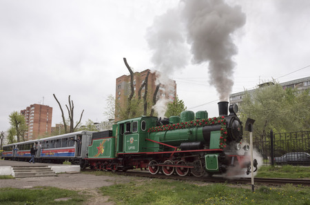 narrowgauge: Rostov-on-Don, Russia- May 1, 2015: Train with passengers out of the station of narrow-gauge railway Editorial