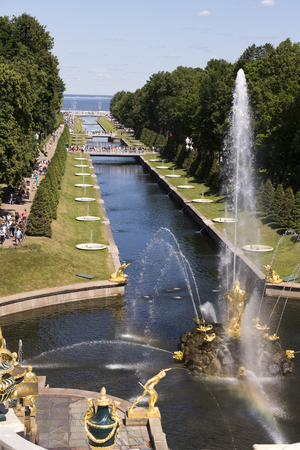 tends: Peterhof, Saint-Petersburg, Russia - July 6,2015: Each guest Peterhof tends to witness the great miracle of the human mind - the unique Grand Cascade. This building is considered to be the most important of the entire grand fountains of Peterhof. The syst
