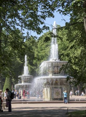 similarity: Peterhof, Saint-Petersburg, Russia - July 6,2015: Roman Fountains-custom name received because of their similarity to the two fountains, set in Rome at St. Peters Cathedral