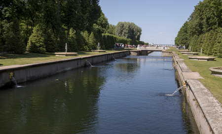 court order: RUSSIA; PETERHOF - JULY 6 - Sea channel with fountains alley. Its width is 12 meters, it was built by order of Peter I. The channel served not only as a decorative feature of Peterhof, in light of the court held it in the middle of the XVIII century. Cust