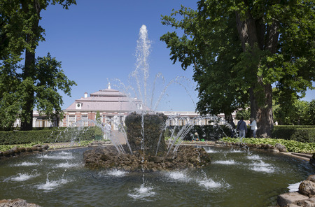 made russia: Peterhof, Saint-Petersburg, Russia - July 6,2015: Fountain Sheaf is a high tuff hill, like a bundle, from which beats a powerful column of water.In five steps, made of marble, water is hiding in a secret channel, creating the impression that it simply d