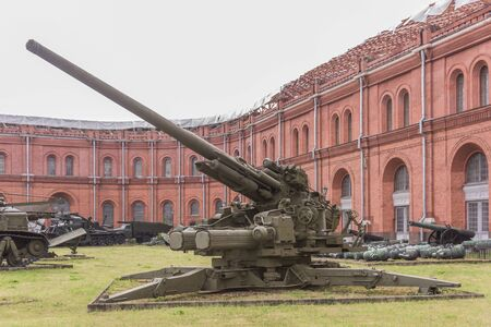 military invasion: RUSSIA; SAINT-PETERSBURG - JULY 8- 130-mm anti-aircraft gun KS-30, mod. 1952. Weight, kg: guns-23 000 ,shell-33 in military history museum  on July 8; 2015 in St. Petersburg Editorial
