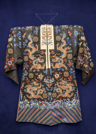 Robe, China, early 20th century. Silk, gold thread, embroidery