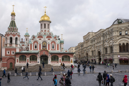 take a history: Moscow, Russia- October 9,2015: Tourists walk on Red Square and take pictures for memory