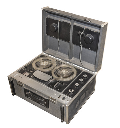 unwind: Spool stereo tape recorder, 1967. Weight 19 kg. Is isolated on white Stock Photo