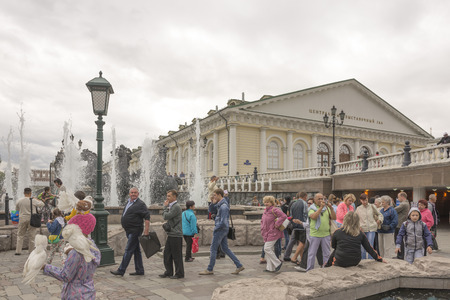 dovetail: MOSCOW; RUSSIA- JULY 13- Citizens walking in the Alexander Garden on July 13; 2015 in Moscow