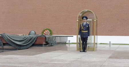 tomb of the unknown soldier: MOSCOW; RUSSIA- JULY 13- Guard at the Eternal Flame Tomb of the Unknown Soldier near the Kremlin wall on July 13; 2015 in Moscow Editorial