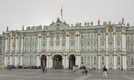 piter: RUSSIA; SAINT-PETERSBURG- JULY 11-Tourists at the Palace Square in the rain on July 11; 2015 in St. Petersburg