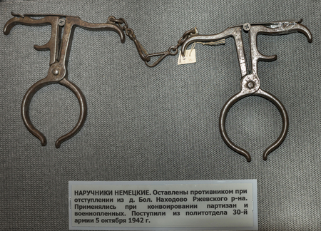 escorting: MOSCOW, RUSSIA- DECEMBER 16- Handcuffs German. Apply with escorting partisans and prisoners of war at the Central Museum of the armed forces  on December 16; 2015 in Moscow