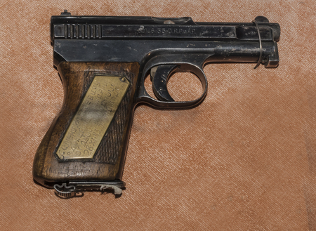glock: MOSCOW, RUSSIA- DECEMBER 16- 6.35-mm pistol Mauser sample 19101934s, Germany at the Central Museum of the armed forces  on December 16; 2015 in Moscow Editorial