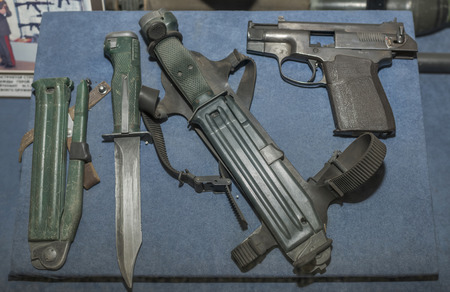 silenced: MOSCOW, RUSSIA- DECEMBER 16- Reconnaissance Weapons: knife, knife shooting, silenced pistol Levchenko system at the Central Museum of the armed forces  on December 16; 2015 in Moscow