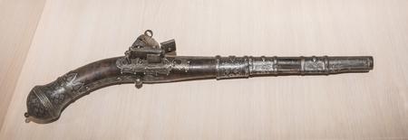 flint gun: STAROCHERKASSKAYA,ROSTOV REGION, RUSSIA- SEPTEMBER 27- Ancient Pistol, 17th century, in Museum-Reserve, in September 27, 2015 in Starocherkasskaya