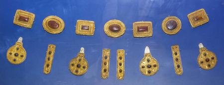 gilding: AZOV, RUSSIA- SEPTEMBER 20- Proniz, caps belts,, suspension of the horse harnesses. 3rd century AD. Silver, bronze, carnelian, glass, gilding in the museum - reserve on September 20;2015 in Azov