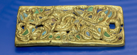 1st century: AZOV, RUSSIA- SEPTEMBER 20-  Belt plate - 1st century AD. Gold,coral, glass, almandine in the museum - reserve on September 20;2015 in Azov Editorial