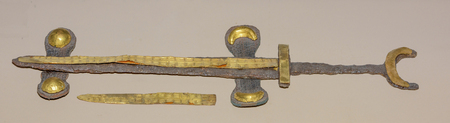 2nd century: AZOV, RUSSIA- SEPTEMBER 20- Dagger decorated with gold foil. The end of the 2nd century AD. Gold, iron, bronze in the museum - reserve on September 20;2015 in Azov
