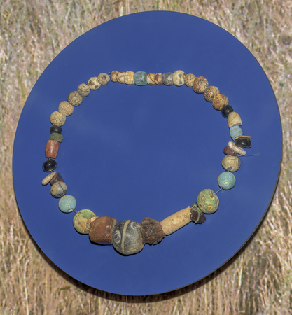 1st century: AZOV, RUSSIA- SEPTEMBER 20-  Necklaces. The end of the 1st century AD. Glass, stone, bone, amber, iron, bronze, gisher, sink in the museum - reserve on September 20;2015 in Azov Editorial