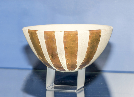 5th: AZOV, RUSSIA- SEPTEMBER 20- Reconstruction of the bowl decorated with four plates. 5th century BC. Gold in the museum - reserve on September 20;2015 in Azov Editorial