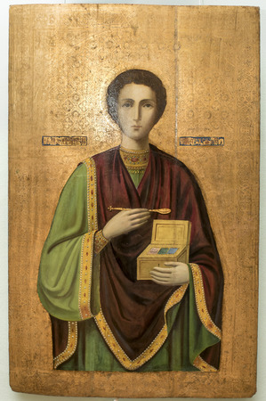 healer: AZOV, RUSSIA- AUGUST 29- Icon St. Panteleimon the Healer. 19th century in the museum - reserve on August 29;2015 in Azov