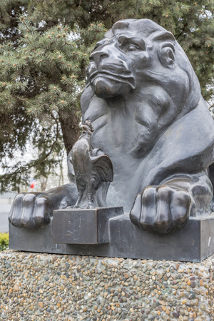 acclaim: ROSTOV-ON-DON, RUSSIA- APRIL 11- Lion guarding the Golden Cockerel (based on the story of Alexander Pushkin). Sculptor D.Lyndin on April 11; 2016 in Rostov-on-Don