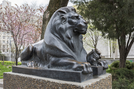 guarding: ROSTOV-ON-DON, RUSSIA- APRIL 11- Lion guarding the Squirrel with golden nut (based on the story of Alexander Pushkin). Sculptor D.Lyndin on April 11; 2016 in Rostov-on-Don