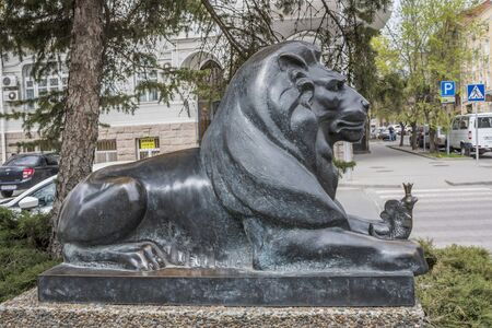 guarding: ROSTOV-ON-DON, RUSSIA- APRIL 11-  Lion guarding the Goldfish (based on the story of Alexander Pushkin). Sculptor D.Lyndin on April 11; 2016 in Rostov-on-Don