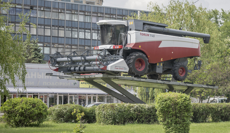 agricultural engineering: ROSTOV-ON-DON, RUSSIA- MAY 11- Combine harvester on a pedestal on May 11;2016 in Rostov-on-Don