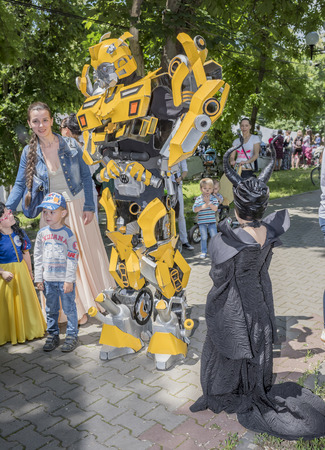 speaks: Rostov-on-Don, Russia- May 22,2016: Robotic speaks with the kids at a carnival in the park named after V. Cherevichkin Editorial