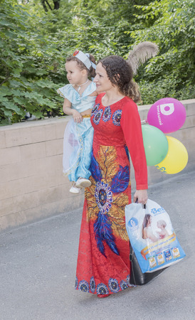 fanfare: Rostov-on-Don, Russia- May 22,2016: Mother walks with her daughter in carnival costume
