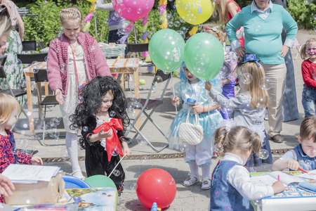 facilitator: Rostov-on-Don, Russia- May 22,2016: Girls catch soap bubbles on holiday