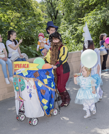 fanfare: Rostov-on-Don, Russia- May 22,2016: Children and parents walk in carnival costumes