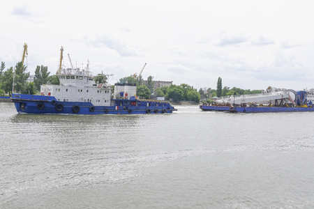 transporting: Transporting marine crane parts along the river in Rostov-on-Don