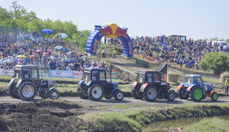 agricultural industry: Rostov-on-Don, Russia- June 05,2016: Competition for agricultural tractors on the green meadow. Bizon Track Show Editorial