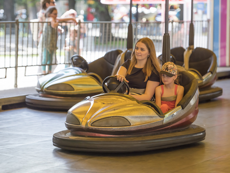 steers: Rostov-on-Don, Russia- June 13: Mother with daughter ride attraction Circuit
