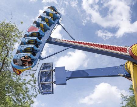 Rostov-on-Don, Russia- June 13: Brave citizens ride the attraction Kamikaze in amusement park Editorial