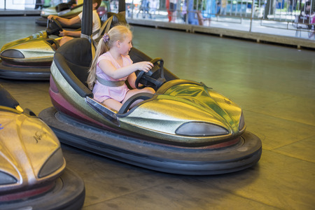 steers: Rostov-on-Don, Russia- June 13: Girl  ride attraction Circuit in amusement park