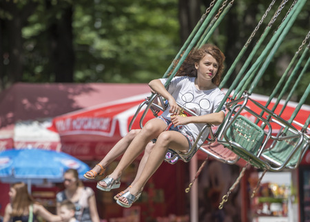 Rostov-on-Don, Russia- June 13: Girl with joy ride on the carousel in amusement park