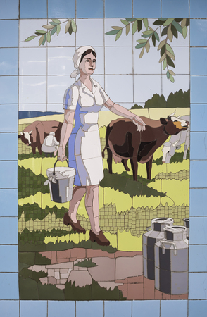 milkman: Rostov-on-Don, Russia- April 29: Milkmaid at the milking - panel from the ceramic tiles in the underpass