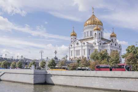 Moscow, Russia -September 06,2016: Christ Temple Saviour.Citizens are moving on the bridge, and the other citizens and vehicles moving along the waterfront