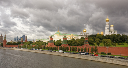 Moscow.View of the Kremlin from the Great Moskvoretsky bridge. On the Kremlin embankment moving people and cars Editorial
