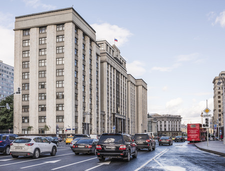establishment states: Moscow, Russia -September 08,2016: The building the State Duma. Along the street Okhotny Ryad moving pedestrians and cars Editorial