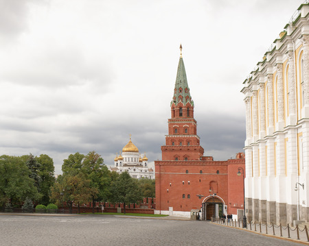 Moscow, Russia -September 09,2016: Kremlin tower Borovitskaya. At the post stands guard. Tourists come to the Kremlin